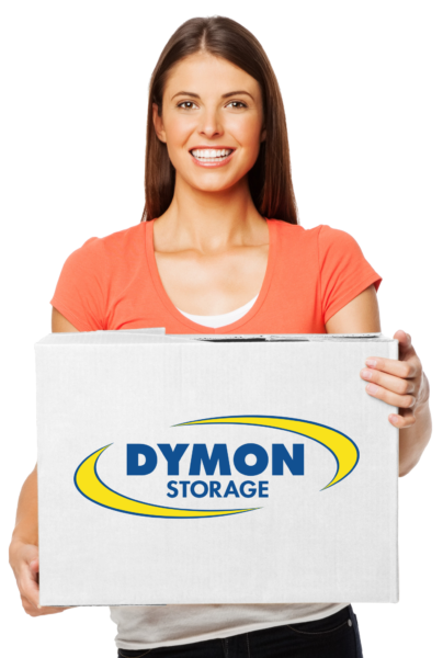 Young female, shown from waist up. holding a white Dymon Storage moving box